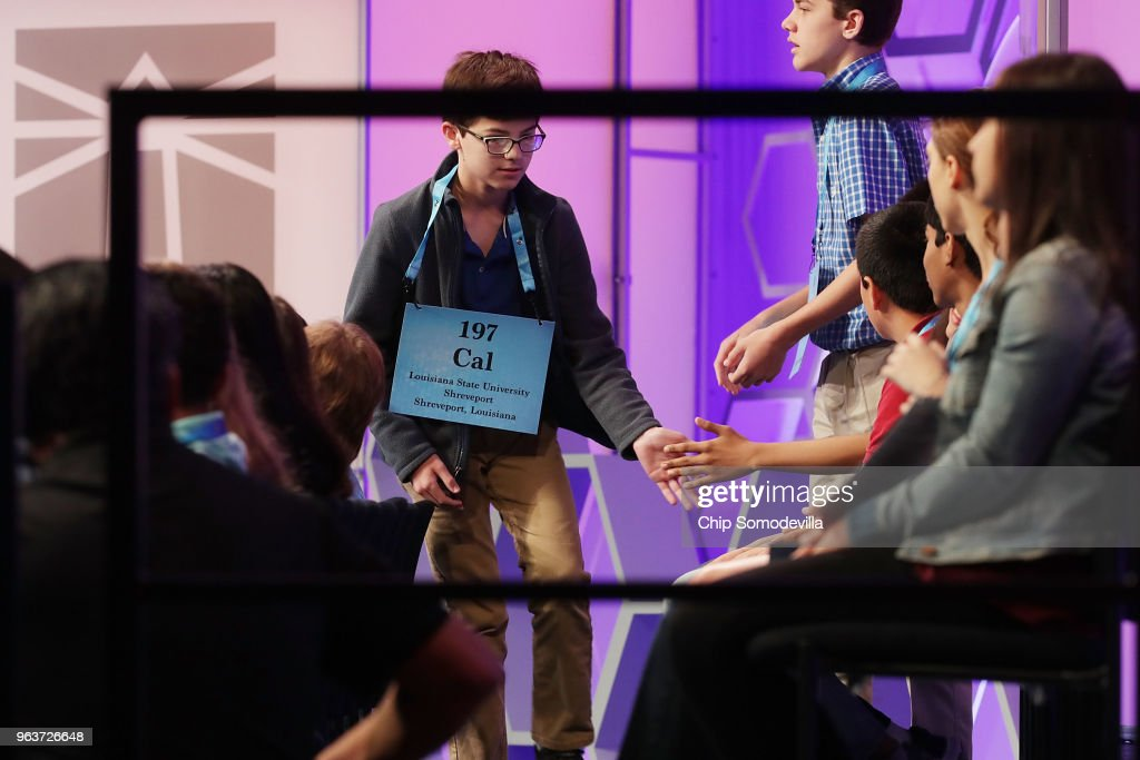 Calvin Alexander, 13, of Shreveport, Louisiana, is congratulated by fellow competitors during the 91st Scripps National Spelling Bee at the Gaylord National Resort and Convention Center May 30, 2018 in National Harbor, Maryland. 516 spellers from across the country and around the world competed in the bee.