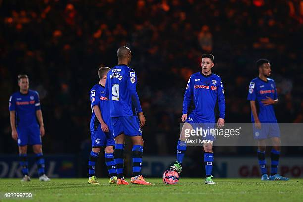 Calvin Andrew and Ian Henderson of Rochdale prepare to restart after conceding the fourth goal during the FA Cup fourth round match between Rochdale...