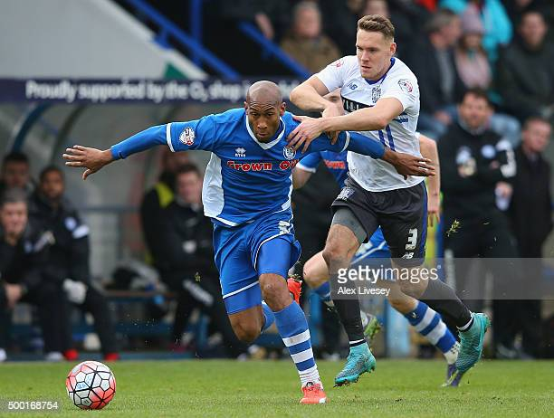 Calvin Andrew of Rochdale holds off a challenge from Chris Hussey of Bury during The Emirates FA Cup Second Round match between Rochdale and Bury at...