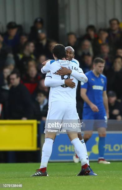Calvin Andrew of Rochdale is congratulated by team mate M J Williams after scoring the opening goal during the Sky Bet League One match between AFC...