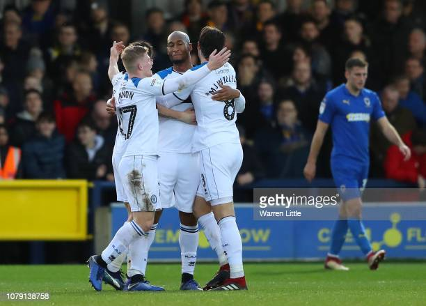 Calvin Andrew of Rochdale is congratulated by team mates after scoring the opening goal during the Sky Bet League One match between AFC Wimbledon and...