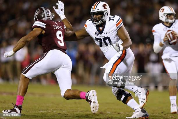 Calvin Ashley of the Auburn Tigers guards as Montez Sweat of the Mississippi State Bulldogs rushes during a game at Davis Wade Stadium on October 6...