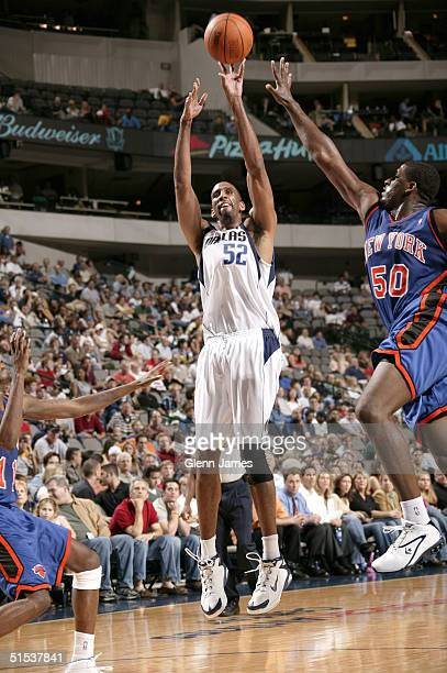 Calvin Booth of the Dallas Mavericks shoots the ball against the New York Knicks on October 21 2004 at the American Airlines Center in Dallas Texas...