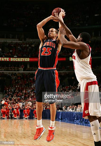 Calvin Brock of the Illinois Fighting Illini attempts a shot against Alando Tucker of the Wisconsin Badgers during the semifinals of the Big Ten...