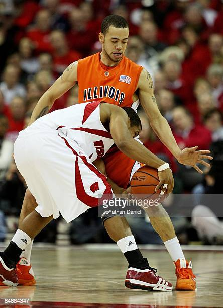 Calvin Brock of the Illinois Fighting Illini defends against Jordan Taylor of the Wisconsin Badgers on February 5, 2009 at the Kohl Center in...