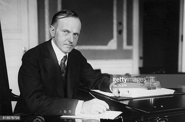 Calvin Coolidge 30th President sitting at his desk Photograph