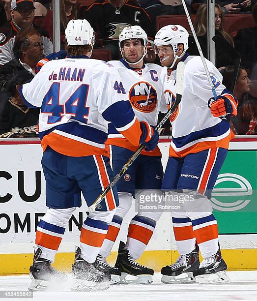 Calvin de Haan, John Tavares and Kyle Okposo of the New York Islanders celebrate Tavares' first period goal during the game against the Anaheim Ducks...