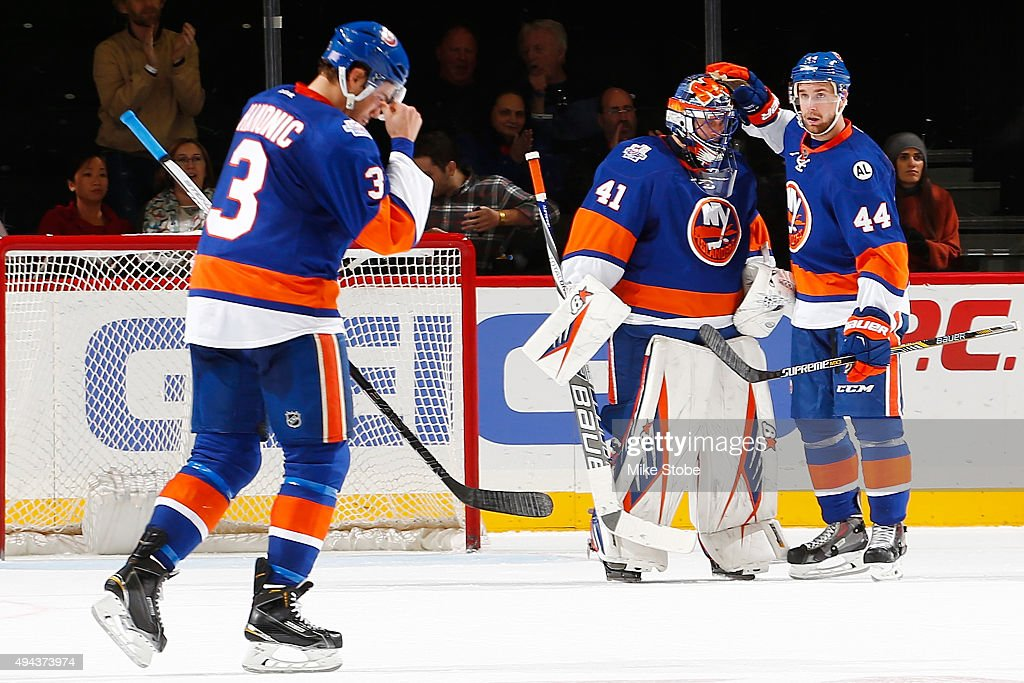 Calvin de Haan #44 of the New York Islanders congratulates Jaroslav Halak #41 on his shut out against the Calgary Flames at the Barclays Center on October 26, 2015 in Brooklyn borough of New York City.