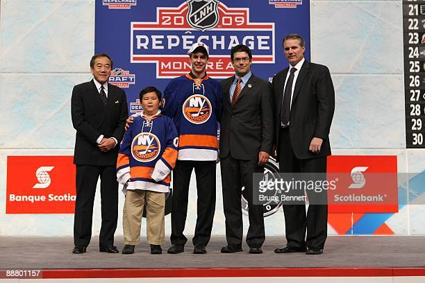 Calvin de Haan poses with members of the New York Islanders organization Team Owner Charles Wang Assistant General Manager/Director of Amateur...