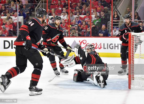Calvin de Haan Warren Foegele and Justin Faulk watch as Curtis McElhinney of the Carolina Hurricanes makes a save against the New York Islanders in...