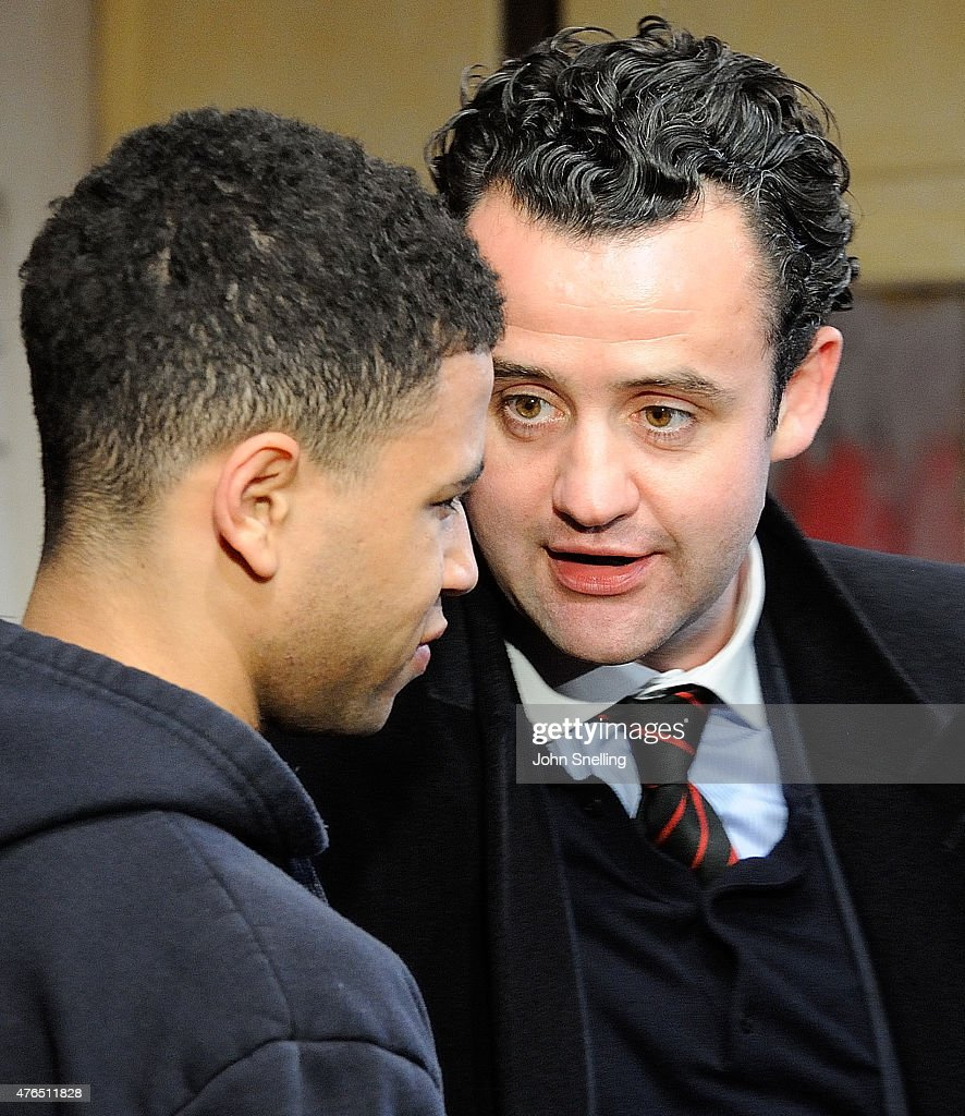Calvin Demba, as Jordan and Daniel Mays, as Kidd perform on stage during a performance of 'The Red Lion' a new play by Patrick Marber at The National Theatre on June 9, 2015 in London, England.