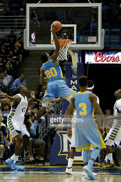 Calvin Godfrey of the Southern Jaguars goes in for the one handed jam during the first half of play against the Marquette Golden Eagles at BMO Harris...