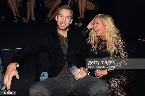 Calvin Harris and Ellie Goulding pose in the VIP Glamour Pit during the MTV EMA's 2013 at the Ziggo Dome on November 10 2013 in Amsterdam Netherlands