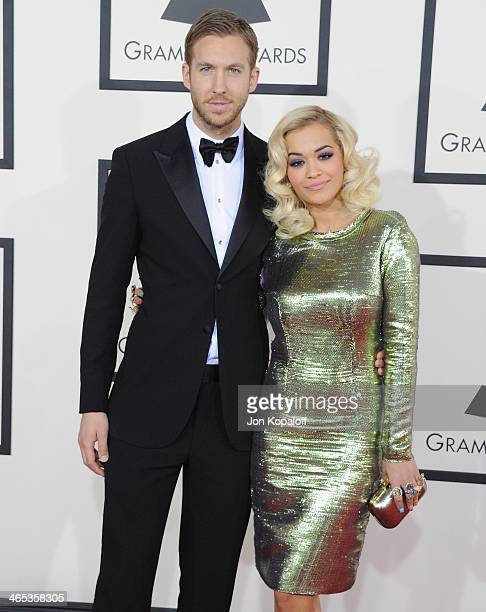 Calvin Harris and Rita Ora arrive at the 56th GRAMMY Awards at Staples Center on January 26 2014 in Los Angeles California