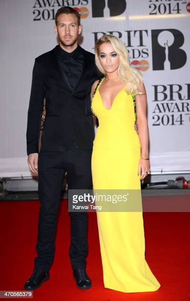 Calvin Harris and Rita Ora attend The BRIT Awards 2014 at 02 Arena on February 19 2014 in London England