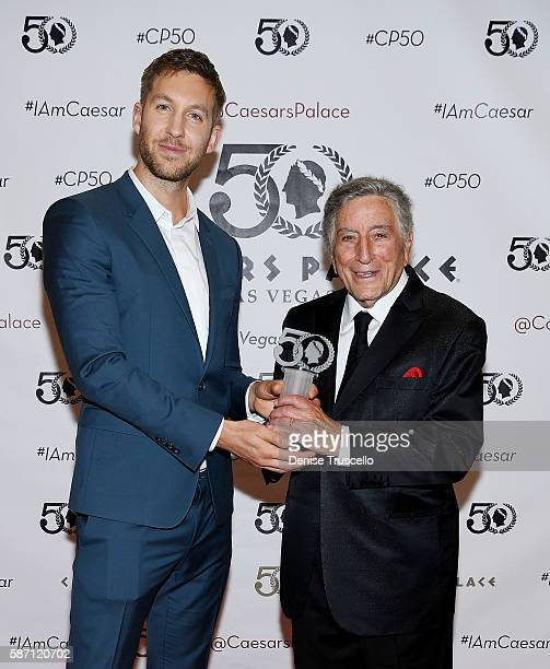 Calvin Harris and singer Tony Bennett attend the 50th anniversary gala at Caesars Palace on August 6 2016 in Las Vegas Nevada