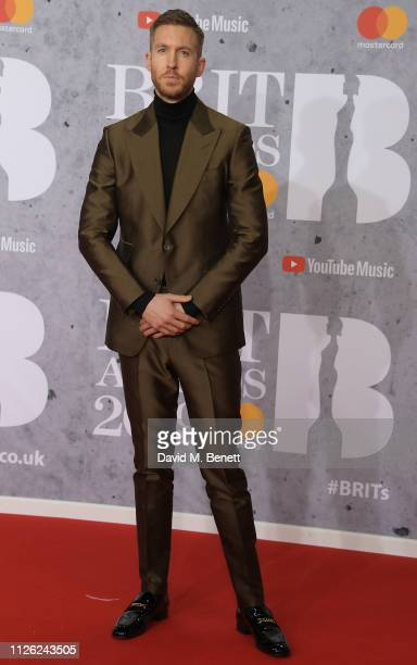 Calvin Harris arrives at The BRIT Awards 2019 held at The O2 Arena on February 20 2019 in London England
