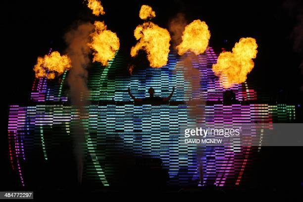 Calvin Harris performs among lights and flames at the Coachella Valley Music Arts Festival at the Empire Polo Club in Indio California April 13 2014...