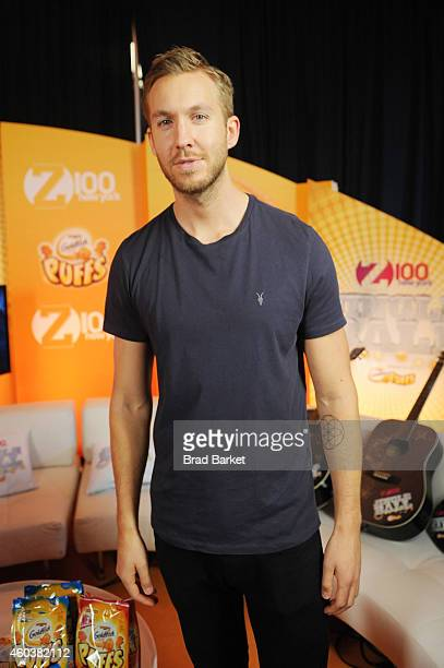 Calvin Harris poses backstage at iHeartRadio Jingle Ball 2014 hosted by Z100 New York and presented by Goldfish Puffs at Madison Square Garden on...
