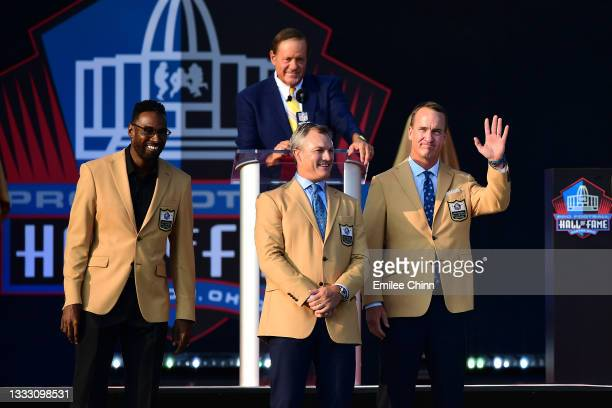 Calvin Johnson, John Lynch and Peyton Manning during the NFL Hall of Fame Enshrinement Ceremony at Tom Benson Hall Of Fame Stadium on August 08, 2021...