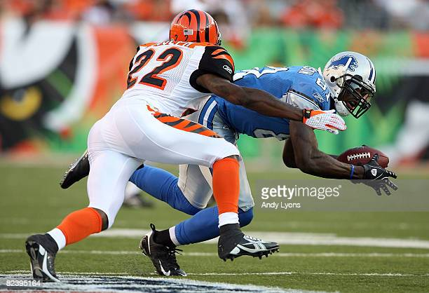 Calvin Johnson of the Detoit Lions catches a pass while defended by Johnathan Joseph of the Cincinnati Bengals during the NFL game against at Paul...