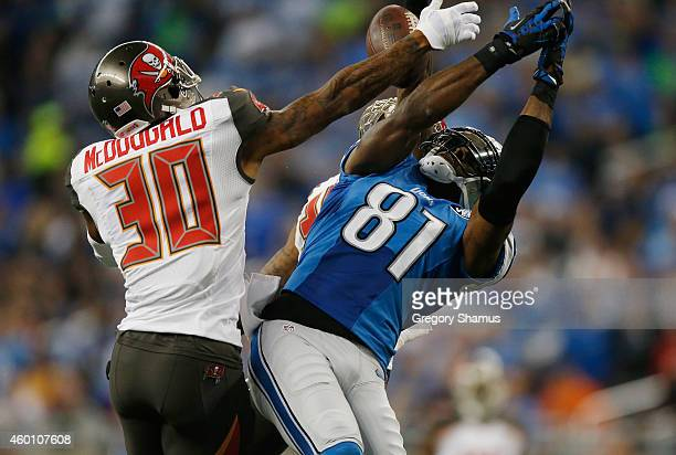 Calvin Johnson of the Detroit Lions breaks up a first quarter catch in front of Bradley McDougald of the Tampa Bay Buccaneers at Ford Field on...