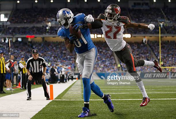 Calvin Johnson of the Detroit Lions catches a first quarter touchdown in front of Johnthan Banks of the Tampa Bay Buccaneers at Ford Field on...