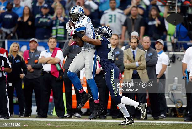 Calvin Johnson of the Detroit Lions catches a pass against Cary Williams of the Seattle Seahawks during the first half of their game at CenturyLink...