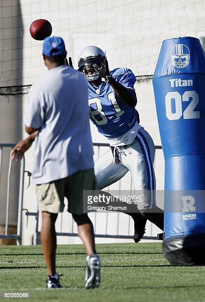 Calvin Johnson of the Detroit Lions catches a pass during training camp at the Detroit Lions Headquarters and Training Facility on July 24 2008 in...