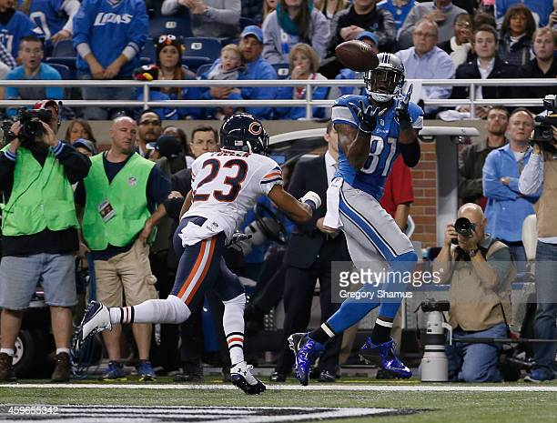 Calvin Johnson of the Detroit Lions catches a second quarter touchdown infront of Kyle Fuller of the Chicago Bears at Ford Field on November 27 2014...