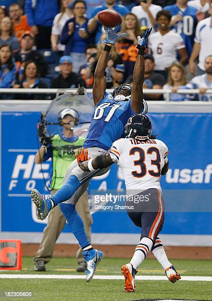 Calvin Johnson of the Detroit Lions catches a secondquarter touchdown pass in front of Charles Tillman of the Chicago Bears at Ford Field on...