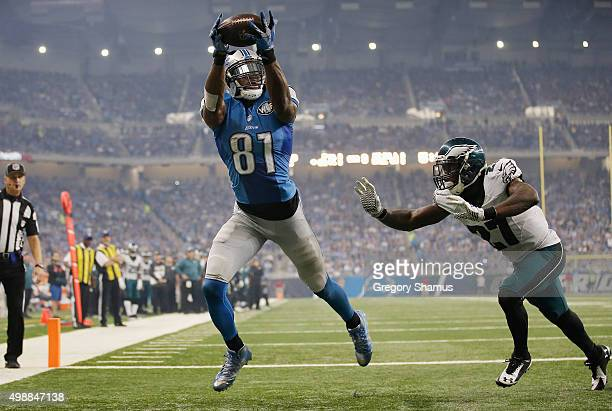 Calvin Johnson of the Detroit Lions catches a third quarter touchdown pass in front of Malcolm Jenkins of the Philadelphia Eagles at Ford Field on...
