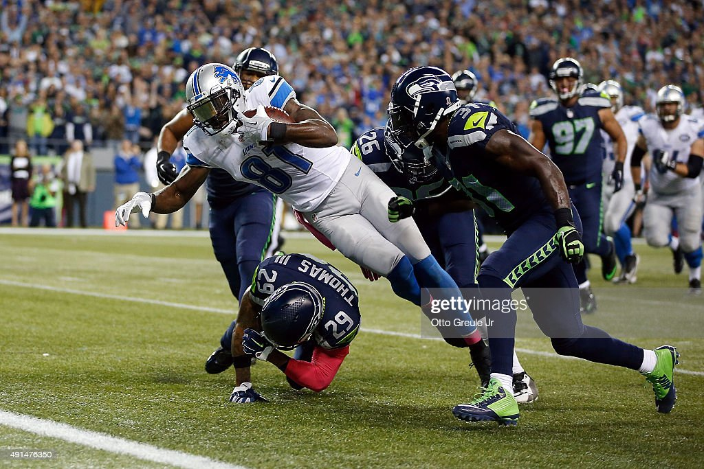 Calvin Johnson #81 of the Detroit Lions dives for the end zone during the fourth quarter of a game against the Seattle Seahawks at CenturyLink Field on October 5, 2015 in Seattle, Washington.