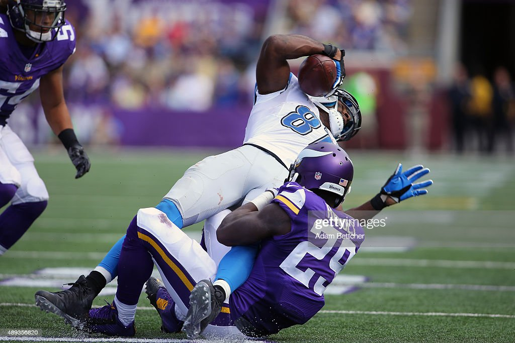 Calvin Johnson #81 of the Detroit Lions gets tackled by Xavier Rhodes #29 of the Minnesota Vikings in the third quarter at TCF Bank Stadium on September 20, 2015 in Minneapolis, Minnesota.