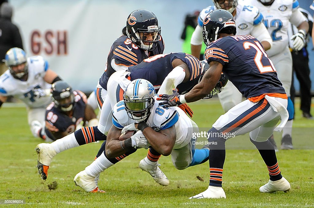 Calvin Johnson #81 of the Detroit Lions is tackled by Harold Jones-Quartey #29 of the Chicago Bears in the third quarter at Soldier Field on January 3, 2016 in Chicago, Illinois.