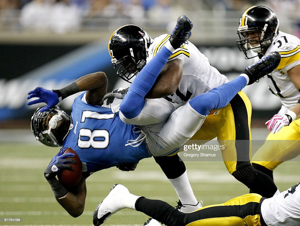 Calvin Johnson #81 of the Detroit Lions is tackled by James Harrison #92 of the Pittsburgh Steelers October 11, 2009 at Ford Field in Detroit, Michigan. Johnson was injured on the play.