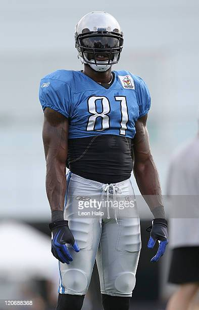 Calvin Johnson of the Detroit Lions looks for the ball during Training Camp at the Detroit Lions Headquarters and Training Facility on August 8, 2011...