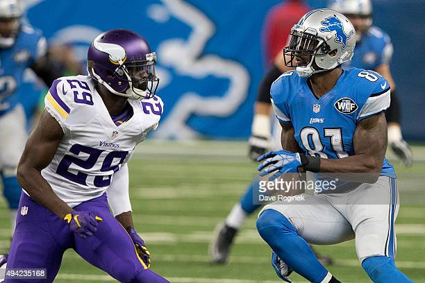 Calvin Johnson of the Detroit Lions looks to avoid the cover by Xavier Rhodes of the Minnesota Vikings in the second half during an NFL game at Ford...