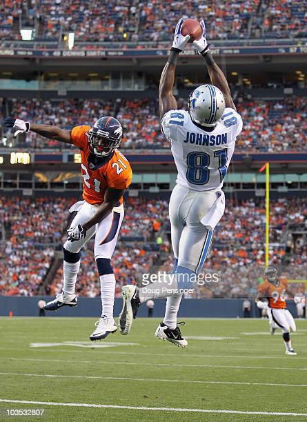 Calvin Johnson of the Detroit Lions makes a 20 yard touchdown catch as Andre Goodman of the Denver Broncos during preseason NFL action at INVESCO...