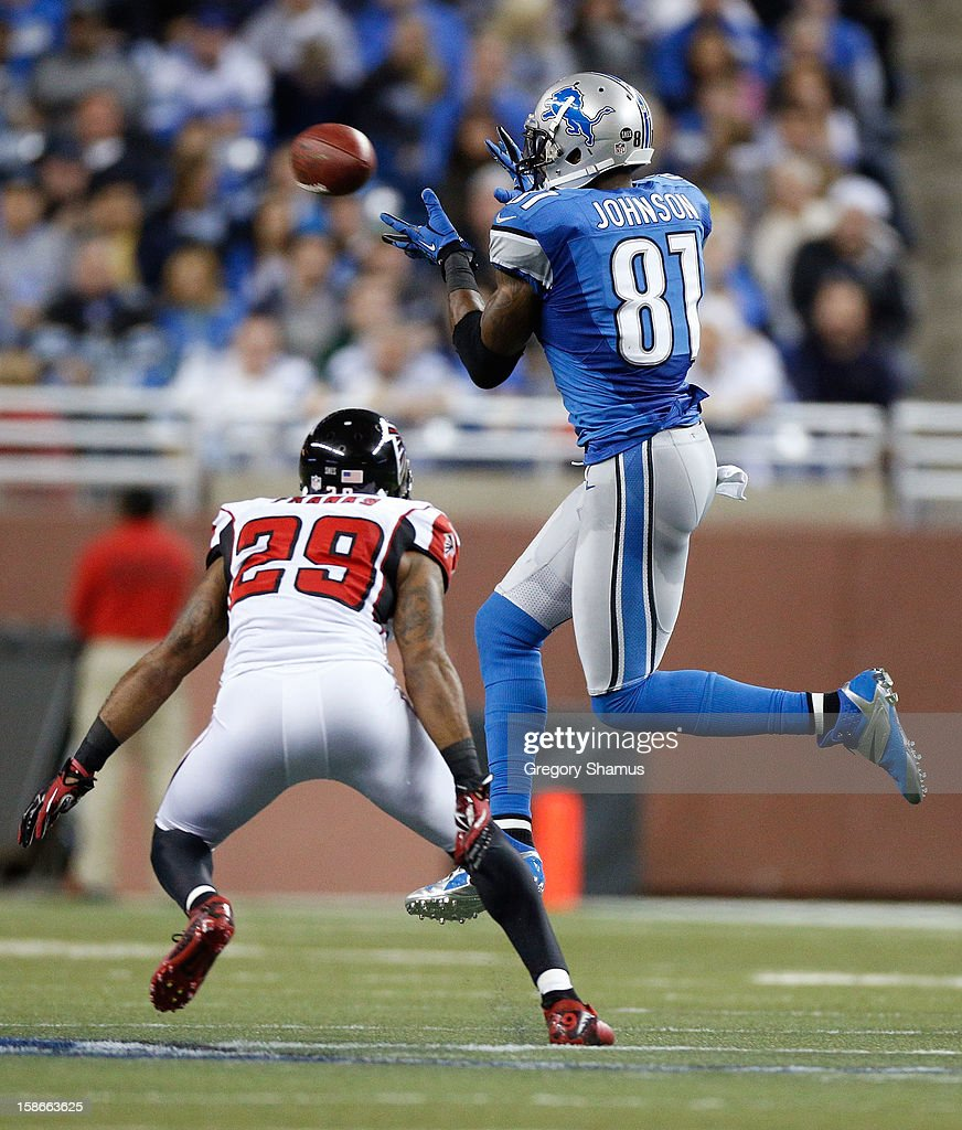 Calvin Johnson #81 of the Detroit Lions makes a third quarter catch in front of Dominique Franks #29 of the Atlanta Falcons at Ford Field on December 22, 2012 in Detroit, Michigan. Atlanta won the game 31-18.