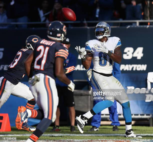 Calvin Johnson of the Detroit Lions makes the gamewinning touchdown catch over Charles Tillman and Major Wright of the Chicago Bears at Soldier Field...