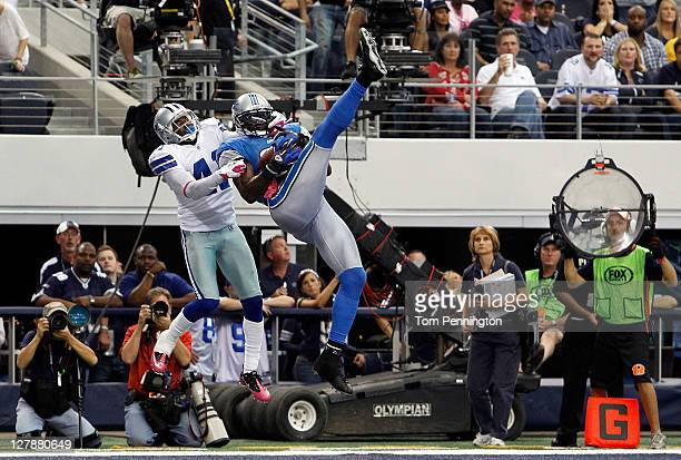 Calvin Johnson of the Detroit Lions pulls in the gamewinning touchdown against Terence Newman of the Dallas Cowboys at Cowboys Stadium on October 2...