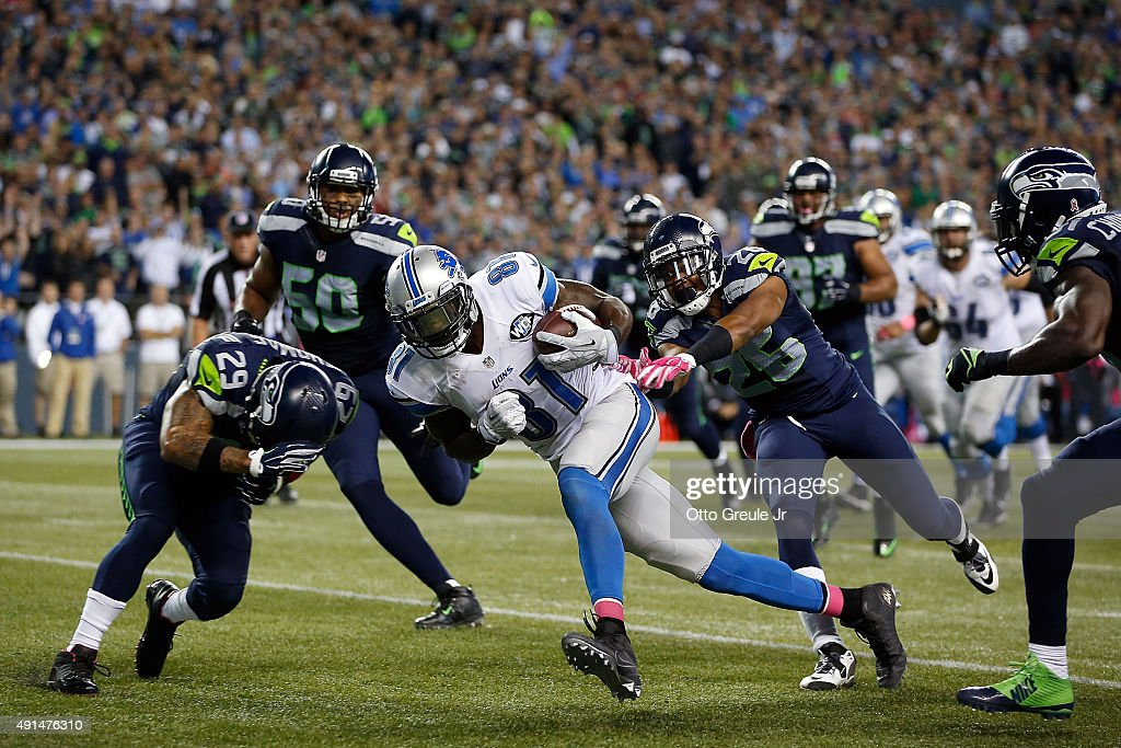 Calvin Johnson #81 of the Detroit Lions runs with the ball during the fourth quarter against the Seattle Seahawks at CenturyLink Field on October 5, 2015 in Seattle, Washington.