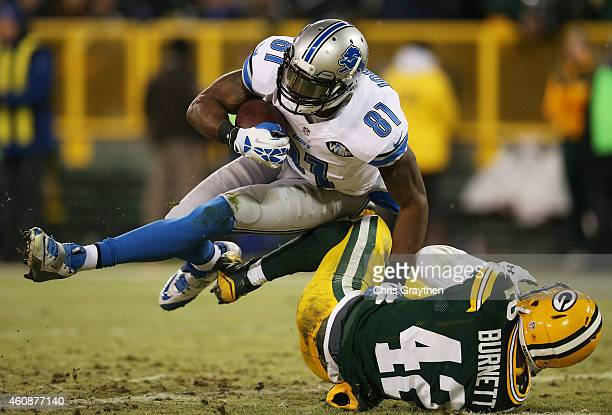 Calvin Johnson of the Detroit Lions scores a touchdown against the defense of Morgan Burnett of the Green Bay Packers in the second quarter at...