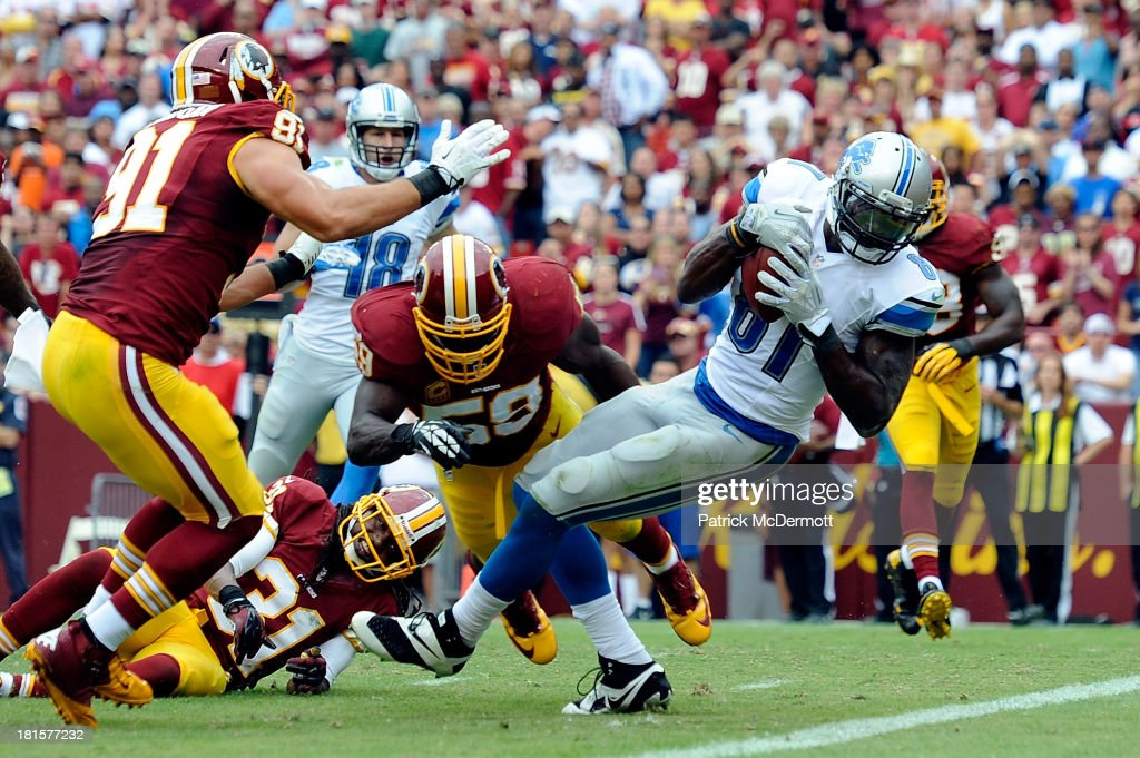 Calvin Johnson #81 of the Detroit Lions scores a touchdown in the fourth quarter during a game against the Washington Redskins at FedExField on September 22, 2013 in Landover, Maryland.