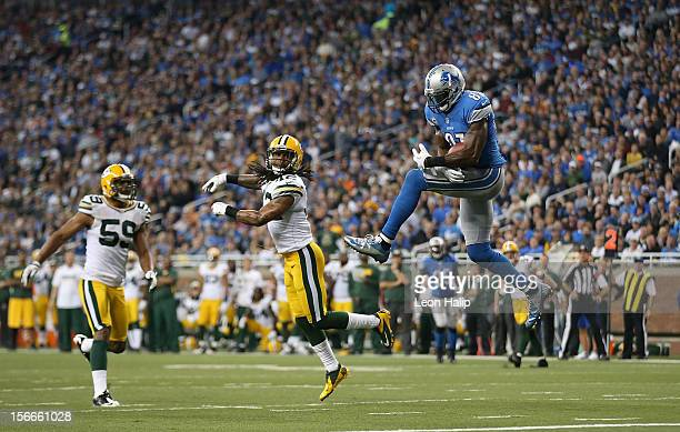 Calvin Johnson of the Detroit Lions scores on a 25 yard touchdown pass from Matthew Stafford during the third quarter of the game against the Green...