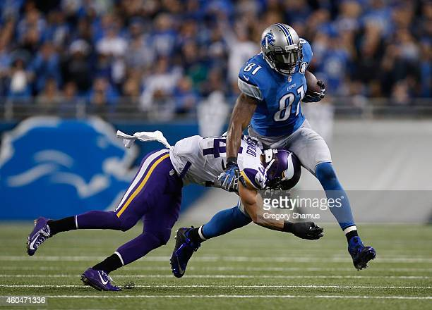Calvin Johnson of the Detroit Lions tries to avoid the tackle by Andrew Sendejo of the Minnesota Vikings in the fourth quarter at Ford Field on...