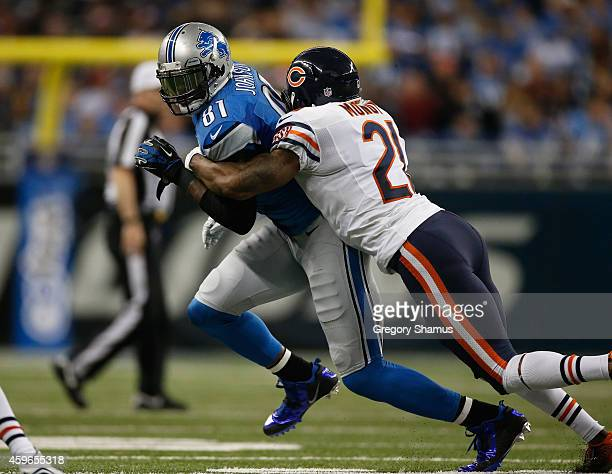 Calvin Johnson of the Detroit Lions tries to avoid the tackle by Ryan Mundy of the Chicago Bears in the second quarter at Ford Field on November 27...