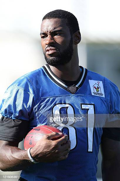 Calvin Johnson of the Detroit Lions watches the morning drills during training camp at the Detroit Lions Training Facility on August 23, 2011 in...