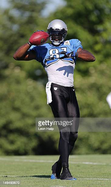 Calvin Johnson of the Detroit Lions works out during the morning practice session on July 29, 2012 in Allen Park, Michigan.
